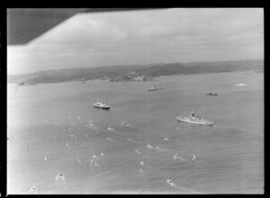 Royal Yacht Britannia with destroyer escort and submarine, Bay of Islands