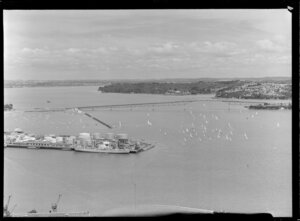 Auckland Harbour Bridge and 'tank farm' with a flotilla of yachts