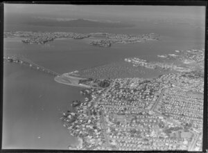 General view of Auckland with Harbour Bridge, Westhaven marina and North Shore with Rangitoto
