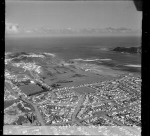 Miramar Peninsula, featuring suburb Strathmore, including Strathmore Park, Scots College, Miramar Golf Links and Wellington Airport, with Lyall Bay in the background