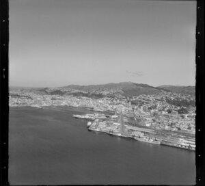 Wellington, city and harbour, featuring ships docked at wharves