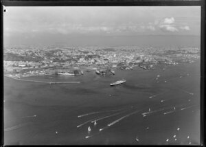 View across Waitemata Harbour, Auckland, showing waterfront, wharves and city buildings
