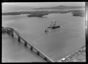 Auckland Harbour Bridge, including barge and cranes used in construction of bridge extensions