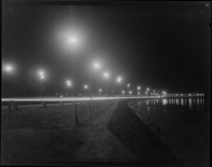 Lights on motorway at night, showing Harbour Bridge Toll Plaza, Auckland