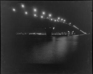 Lights on Auckland Harbour Bridge at night, taken from Fisherman's wharf restaurant