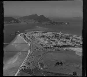 Coastal view featuring Marsden Point Oil Refinery, Whangarei District, Northland Region, including oil tanker docked at wharf
