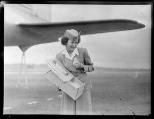 Stewardess, Mrs McFarlane, with baby chicks