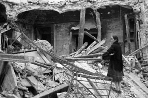 Woman clearing wreckage left by German troops in the village of Gessopalena, Italy