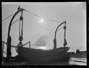 Unidentified ship sailing toward a wharf with a lifeboat, Auckland