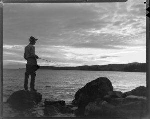 Unidentified man fishing at Lake Taupo