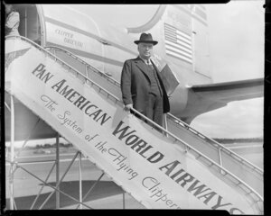 Mr Walter Nash, politician, arriving at [Auckland?] on a Pan American World Airways' Clipper aeroplane
