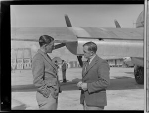 Mr Neville Jackson, pilot, New Zealand National Airways Corporation, left, with Mr AV Jury, Department Operations Manager, Tasman Empire Airways Limited, location unidentified