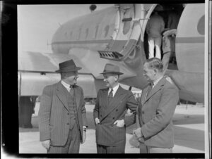 Group from Tasman Empire Airways Limited, including Mr Geoff Roberts, Captain Brownjohn, and an unidentified man, with Handley Page Hastings airplane, location unidentified
