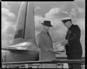 Tasman Empire Airways Limited, kiwi egg in a box with a Kiwi Polish Co (NZ) Ltd label, being handed over, Auckland