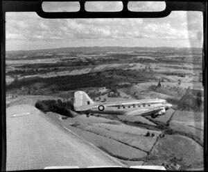 RNZAF (Royal New Zealand Air Force) 41 Squadron, Dakota airplane in flight over Whenuapai airbase, Waitakere City, Auckland