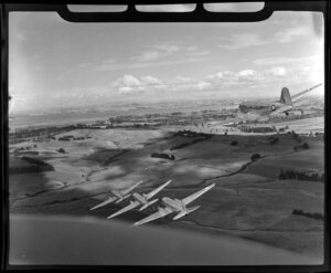 RNZAF (Royal New Zealand Air Force) 41 Squadron, Dakota airplanes flying over Whenuapai airbase, Waitakere City, Auckland