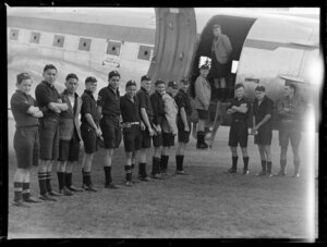 Students from Northland College, boarding a Douglas Dakota airplane