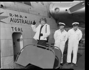 Miss New Zealand, Mary Woodward boarding Tasman Empire Airways Ltd aircraft, RMA Australia with unidentified men standing alongside her