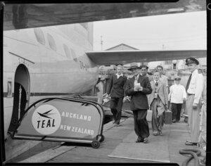 Passenger embarking on the Tasman Empire Airways Ltd Solent seaplane Aotearoa II ZK-AML, Mechanics Bay, Auckland