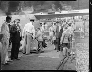 Passengers embarking on the Tasman Empire Airways Ltd Solent seaplane Aotearoa II ZK-AML, Mechanics Bay, Auckland