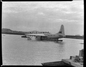 Tasman Empire Airways Ltd, Solent IV flying boat, RMA Aotearoa II, ZK-AML, heading for buoy, Mechanics Bay, Auckland