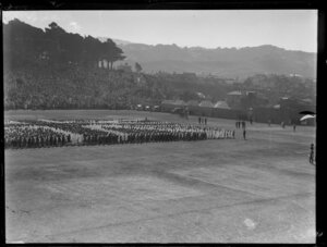 Reception at the Domain, Auckland, for the Duke and Duchess of York, with throng forming a Union Jack on a parade ground