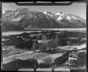 Mt Cook and Southern Lakes Tourist Company Ltd bus, including Mt Cook in the background