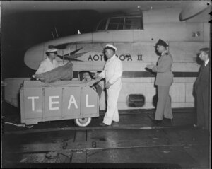 Tasman Empire Airways Ltd, loading meat freight for Suva onto the flying boat, Aotearoa II, [Auckland?]