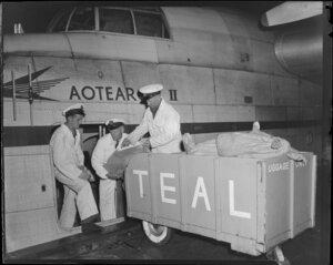 Tasman Empire Airways Ltd, loading meat freight for Suva onto the flying boat, Aotearoa II, [Auckland?]