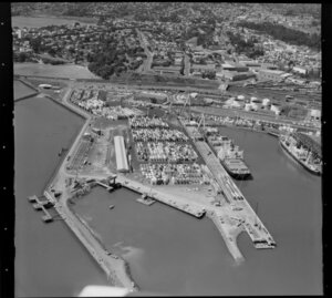 Ships, containers and cranes at Fergusson Wharf, Port of Auckland, Waitemata Harbour, including Main Trunk Line and Parnell