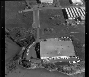 Unidentified factory in industrial area, Manukau City, Auckland, including tidal inlet