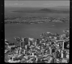View over Auckland City buildings and wharves towards Devonport and Rangitoto Island