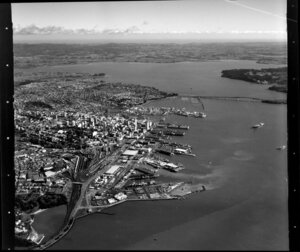 Auckland City looking towards Waitakere City, including Parnell Baths, Port, Railway Station, Harbour Bridge, and Waitemata Harbour