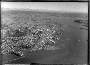 Auckland City and suburbs looking towards Waitakere City, including Waitemata Harbour