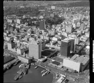 Auckland city waterfront area with shipping and tall buildings