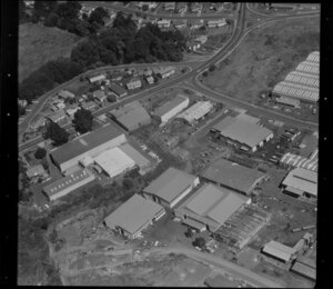 Unidentified factories in industrial area, Auckland, including quarry and wooded area