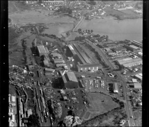 Unidentified factories in industrial area, Manukau City, Auckland, including tidal inlet and railway yards