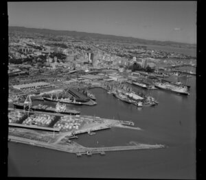Ships, containers and cranes at Port of Auckland, Waitemata Harbour, including Auckland City and Railway Station