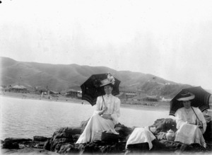 Two women picnicking at Island Bay, Wellington
