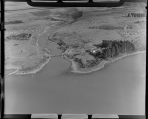 Lake Tekapo and mouth of the Tekapo River, Mackenzie Country, including large homestead, bridge and temporary housing for workers on the hydro-electric power scheme
