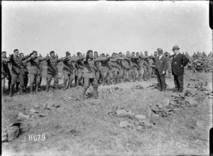 Members of the Pioneer Battalion performing a haka for ministers Massey and Ward, Bois-de-Warnimont, France
