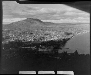 View of Taupo, including Waikato River flowing into Lake Taupo and Mount Tauhara, Waikato region