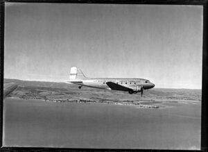 New Zealand National Airways Corporation (NAC) Flagship Dakota aircraft in flight over Auckland