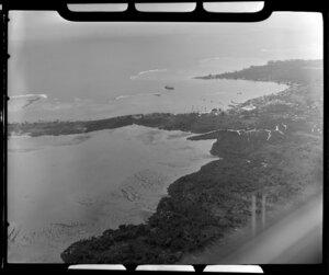 Apia, Upolu, Samoa, showing village and bay