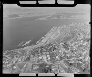 Wellington, with Wadestown in foreground and ships moored at wharves at Aotea Quay