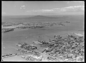 Waterfront scene, including cruise ship Orcades and other ships, Davonport and Rangitoto Island, Auckland