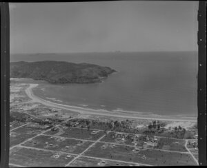 Whangamata, Thames-Coromandel District, showing part of town, beach and Inlet