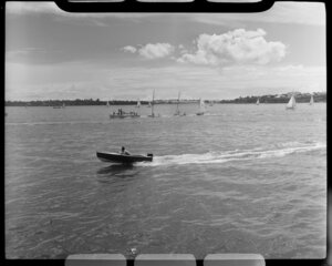 Auckland Anniversary Regatta, Auckland Harbour, showing sailing boats and small speed boat in foreground