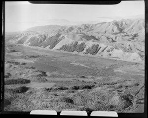 Raumati, Kapiti Coast District, showing tussock land and hills
