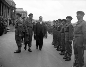 The Prime Minister, Sidney Holland, reviewing SAS Squadron on parade in front of Parliament, October 1955